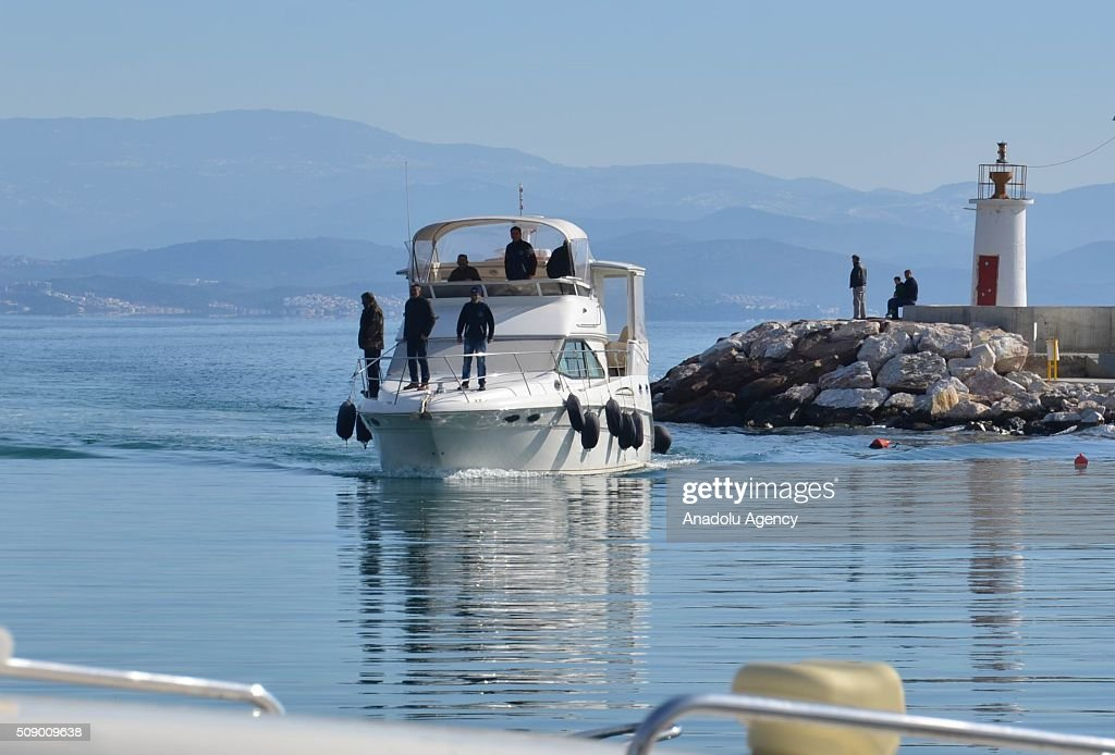 People are seen on a boat as a refugee boat sank in the Aegean sea at Edremit bay in Balikesir, Turkey on February 8, 2016. 22 refugees lost their lives, only 4 of them were rescued.