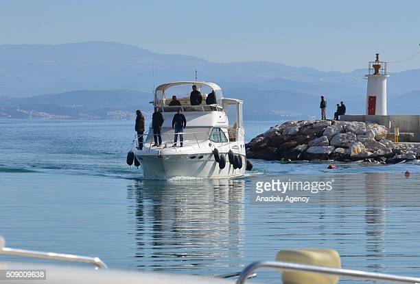 People are seen on a boat as a refugee boat sank in the Aegean sea at Edremit bay in Balikesir Turkey on February 8 2016 22 refugees lost their lives...