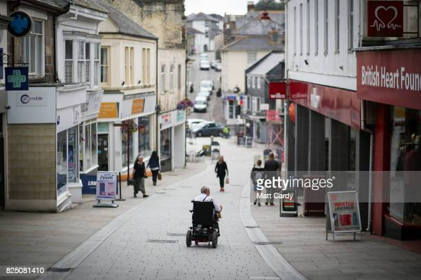 People are seen on the main street in Redruth on July 24 2017 in Cornwall England Figures released by Eurostat in 2014 named the British county of...