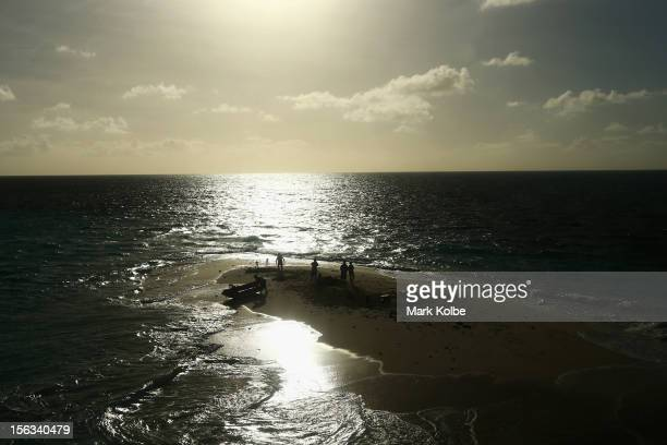 People are seen on Vlassof Cay to view the solar eclipse on November 14 2012 in Palm Cove Australia on November 14 2012 in Cairns Australia Thousands...