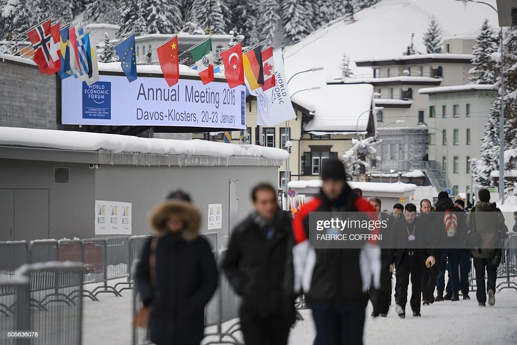 People are seen outside of the Congress Center at the opening of the World Economic Forum annual meeting in Davos on January 19 2016 More than 40...