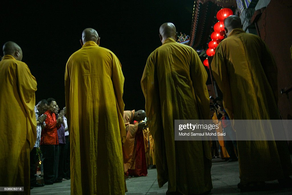 People are seen perform a prayer inside the Guan Yin temple ahead of Lunar New Year of the monkey celebrations on February 7, 2016 outside Kuala Lumpur, Malaysia. According to the Chinese Calendar, the Lunar New Year which falls on February 8 this year marks the Year of the Monkey, the Chinese Lunar New Year also known as the Spring Festival is celebrated from the first day of the first month of the lunar year and ends with Lantern Festival on the Fifteenth day.