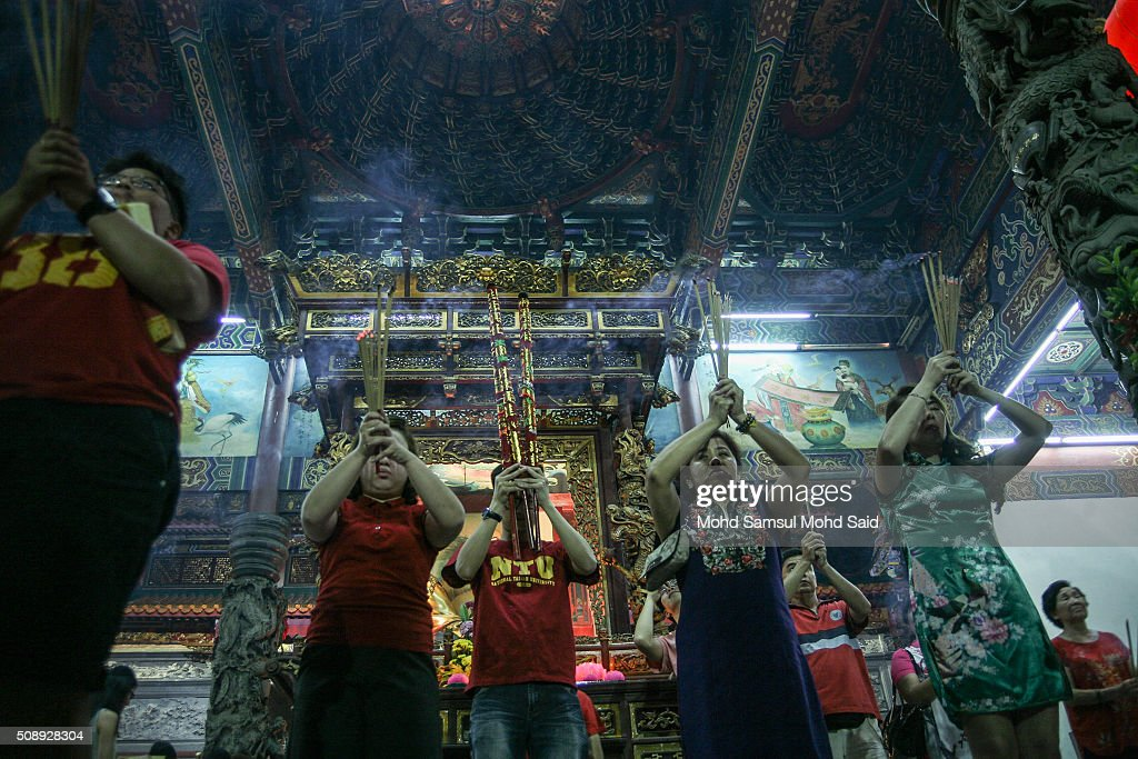 People are seen perform a prayers inside the Guan Yin temple ahead of Lunar New Year of the monkey celebrations on February 7, 2016 outside Kuala Lumpur, Malaysia. According to the Chinese Calendar, the Lunar New Year which falls on February 8 this year marks the Year of the Monkey, the Chinese Lunar New Year also known as the Spring Festival is celebrated from the first day of the first month of the lunar year and ends with Lantern Festival on the Fifteenth day.