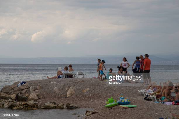 People are seen relaxing on a beach on the island of Krk Croatia on 24 July 2017