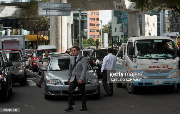 People are seen stuck in traffic as teachers block an avenue during a protest against the educational reform proposed by President Enrique Pena Nieto...