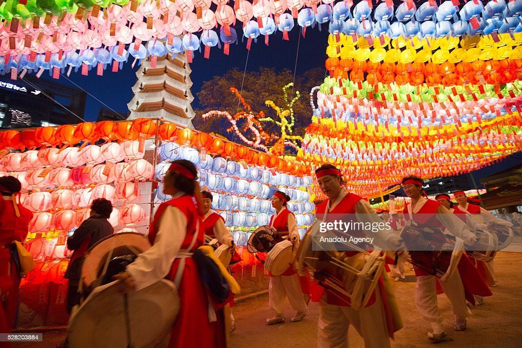 People are seen under lanterns during a Lighting ceremony for the Lotus Lantern Festival to celebrate Buddha's birthday at the Jogye temple on May 4, 2016 in Seoul, South Korea.