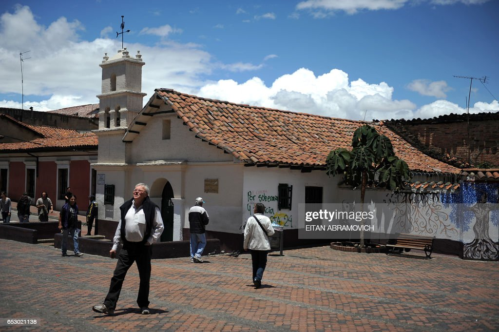 People are seen visiting the El Chorro de Quevedo square in the historic neighborhood of La Candelaria in Bogota on September 17, 2009. La Candelaria is Bogota's oldest neighbourhood and the city's historical center, known for its colonial houses with wooden balconies and clay shingle roofs. AFP PHOTO/Eitan Abramovich /