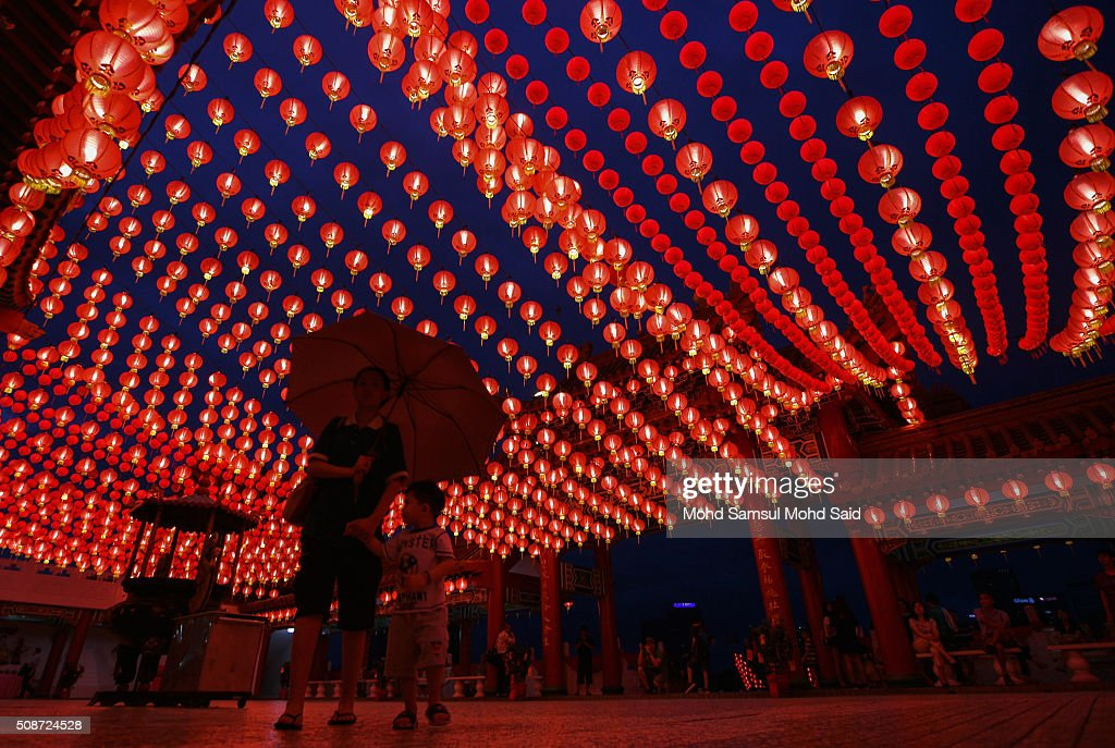 People are seen walking inside the Thean Hou temple with lanterns decorated ahead of Lunar New Year of the monkey celebrations on February 6, 2016 in Kuala Lumpur, Malaysia. According to the Chinese Calendar, the Lunar New Year which falls on February 8 this year marks the Year of the Monkey, the Chinese Lunar New Year also known as the Spring Festival is celebrated from the first day of the first month of the lunar year and ends with Lantern Festival on the Fifteenth day.