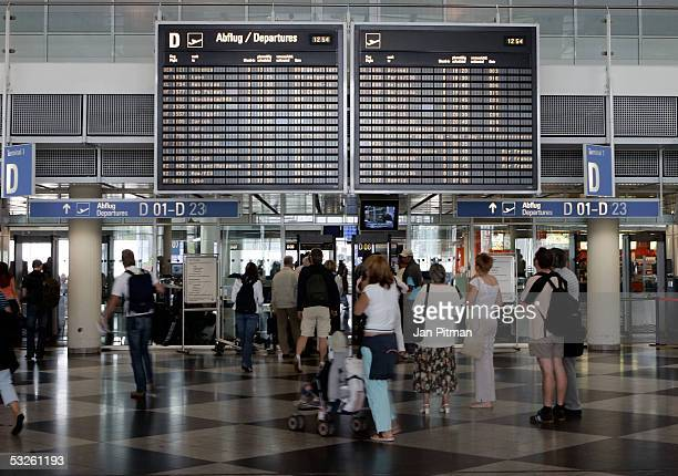 People are shown walking through the departure area July 20 2005 at the FranzJosef Strauss Airport in Munich Germany