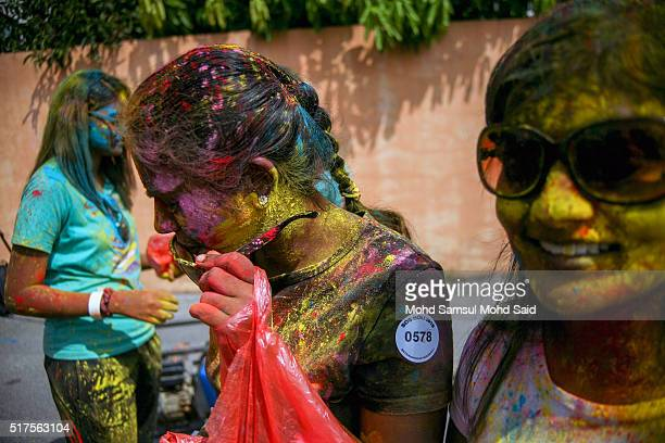 People are smile as their faces covered in coloured powder during Holi festivals at a temple on March 26 2016 in Kuala Lumpur Malaysia Holi also...