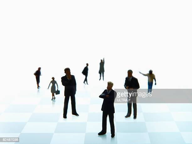 people are standing on the chess board.