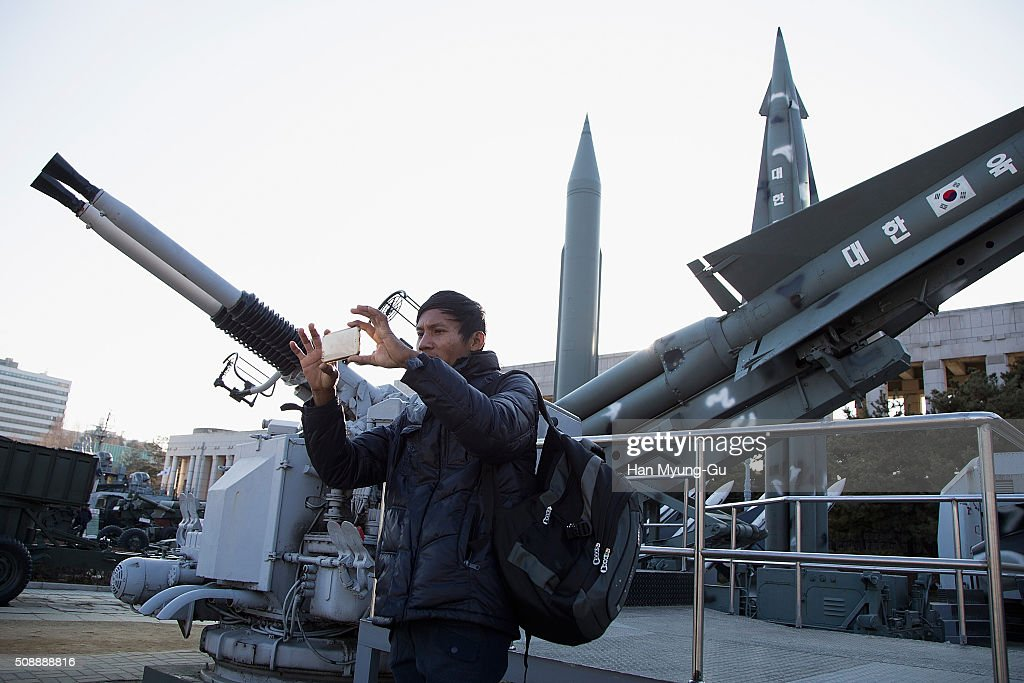 People are taking pictures with a display of model missiles including a North Korean Scud-B at the War Memorial of Korea on February 7, 2016 in Seoul, South Korea. North Korea launched a long-range rocket carrying a satellite on February 7, 2016. The launch is considered by Western experts as part of a program to develop intercontinental ballistic missile technologies, banned by the multiple of past resolutions of the U. N. Security Council against the country. South Korea, the United States and Japan have requested an emergency meeting of the U.N. Security Council.