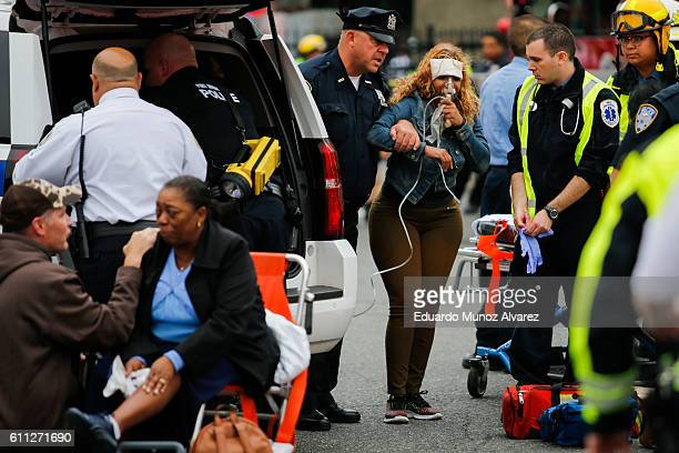 People are treated for their injuries outside after a NJ Transit train crashed in to the platform at Hoboken Terminal September 29 2016 in Hoboken...