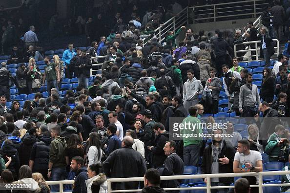 People are urgently evacuated from the stadium following a bomb threat made during the 20142015 Turkish Airlines Euroleague Basketball Regular Season...