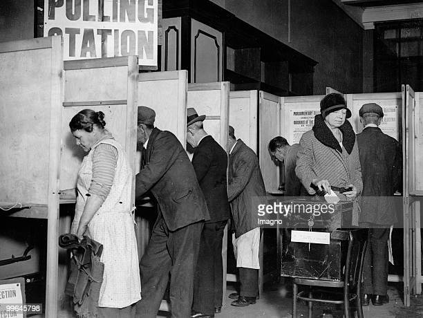 People are voting at the polling station at the Tottenheim Court Road at 7h am Holborn London Photograph 27 10 1931 Photo by Austrian Archives...