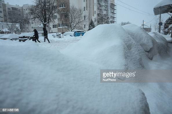 people are walking as snow falls at the streets of Svilengrad Bulgaria on January 11 2017 Snow paralyse Bulgaria The snow reached 40 70 sm at...