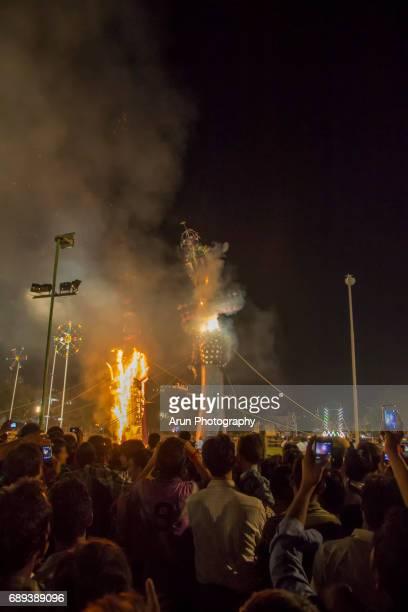 People are watching the burning of evil effigies'Ravana'