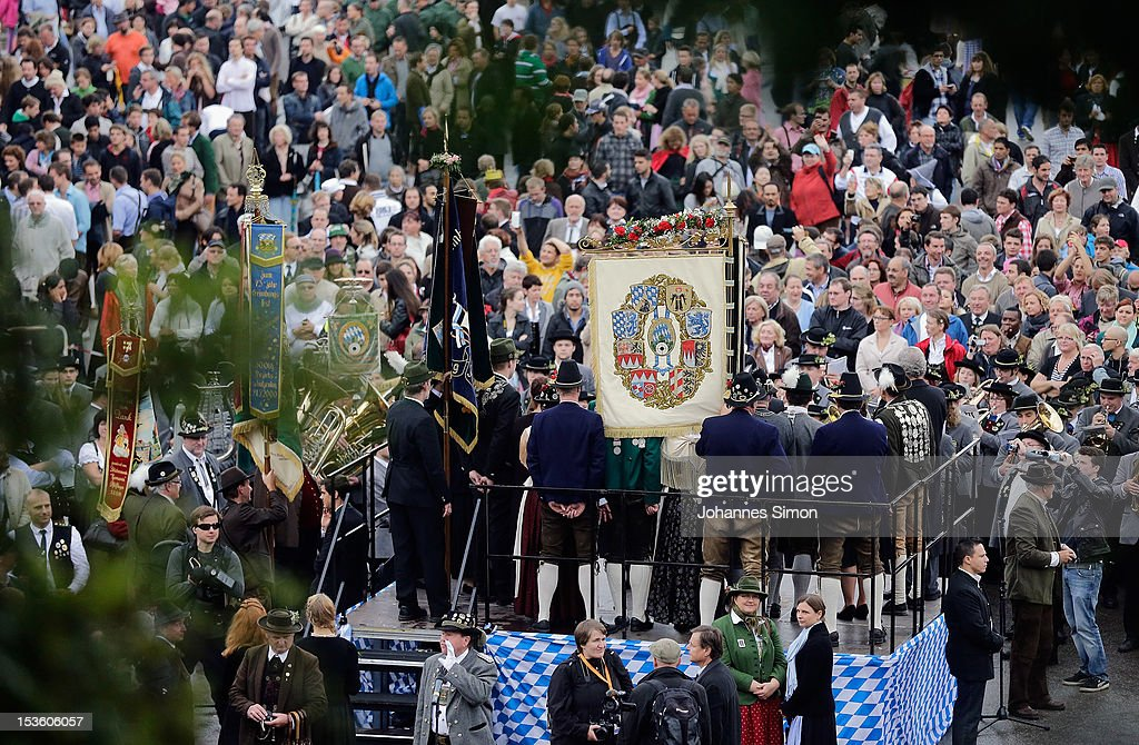 People are watching the traditional 'Boellerschiessen' (firing of a salute with a special gun) on the last day of Oktoberfest beer festival on October 7, 2012 in Munich, Germany. The 'Boellerschiessen' officially signifies the closing of this year's edition of the world's biggest beer festival.