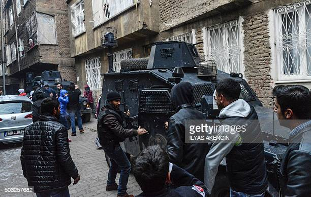 People argue with Turkish police during clashes at the Sur district in Diyarbakir southeastern Turkey on January 3 2016 Tensions are running high...