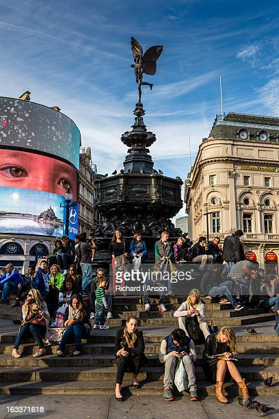 People around Eros statue at Piccadilly Circus