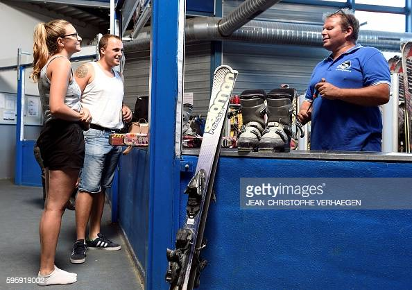 People arrive and choose their ski equipment at the Snowhall the only indoor ski run in France in Amneville eastern France on August 26 2016 as a...