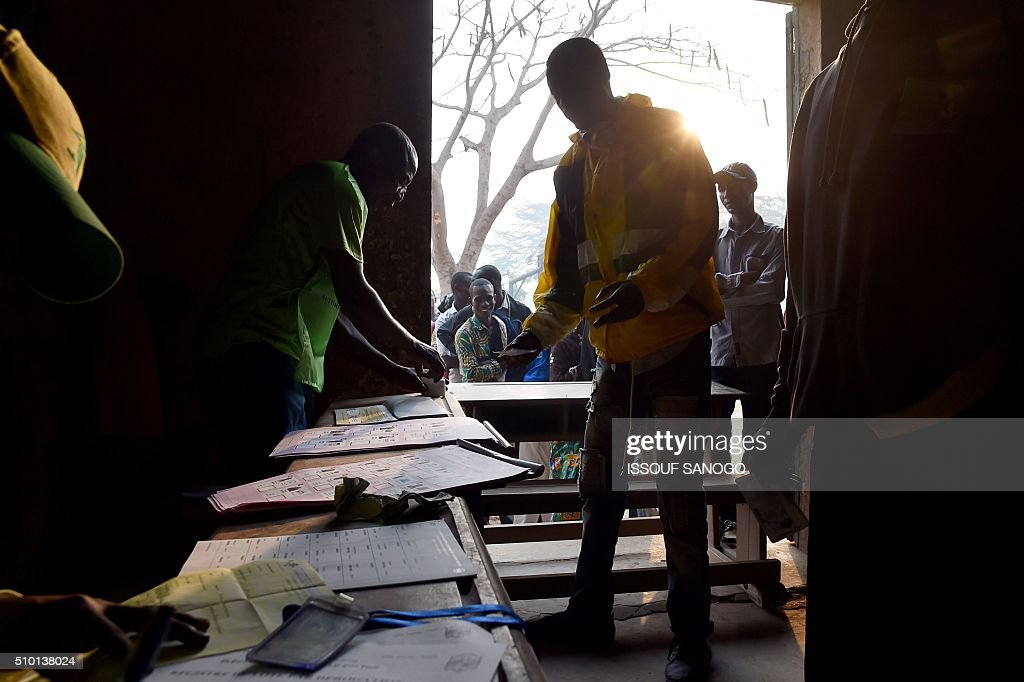 People arrive and queue at a polling station in the muslim district of PK 5 before voting on February 14, 2016 as people go to the polls to take part in the Central African Republic second round of the presidential and legislative elections. Voters in the Central African Republic began casting ballots on February 14 in delayed legislative elections and a presidential run-off which they hope will bring peace after the country's worst sectarian violence since independence in 1960.The nation, dogged by coups, violence and misrule since winning independence from France, could take a step towards rebirth if the polls go smoothly. SANOGO