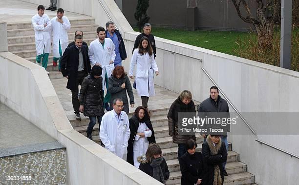 People arrive as Don Luigi Maria Verze lies in repose at the San Raffaele Hospital ahead of his funeral on January 2 2012 in Milan ItalyDon Luigi...