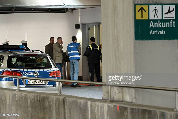 People arrive at a holding area for friends and relatives of passengers on Germanwings flight 4U9525 from Barcelona to Duesseldorf at Duesseldorf...