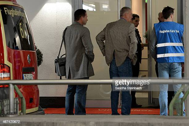 People arrive at a holding area for friends and relatives of passengers on Germanwings flight 4U9525 from Barcelona to Dusseldorf at Dusseldorf...