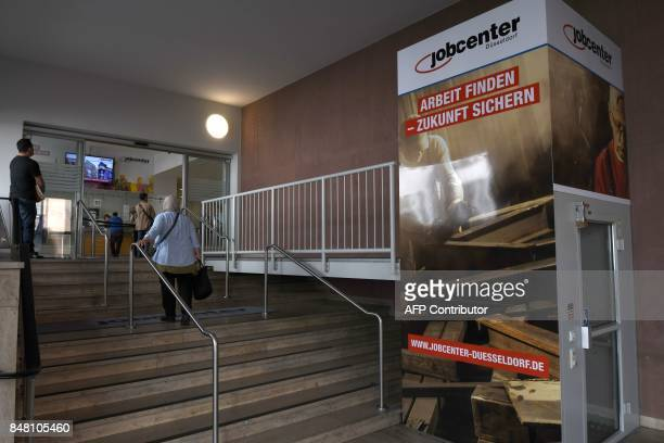 People arrive at a Jobcenter in DuesseldorfMitte western Germany on August 25 2017 The number of people out of work has halved in Germany since 2005...