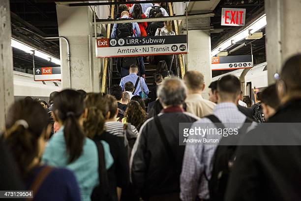 People arrive at New York Penn Station from a NJ Transit train on May 13 2015 in New York City An Amtrak train crash in Philadelphia last night has...