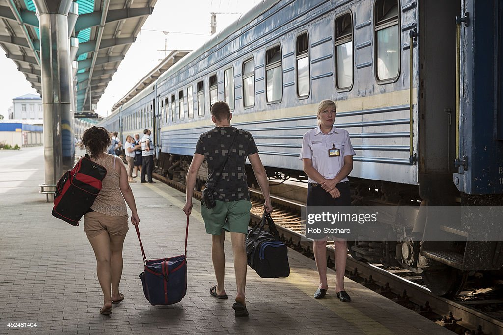 People arrive at the central railway station to take the train to Sevastopol on July 21, 2014 in Donetsk, Ukraine. Local authorities warned residents in the area not to go outside or leave their homes whilst intense shelling set a market ablaze close to the station. The security situation is continuing to affect the investigation into the Malaysian Airlines flight MH17 crash and it is still unclear where or when the train containing the bodies of victims will be moved. Malaysian Airlines flight MH17 was travelling from Amsterdam to Kuala Lumpur when it crashed killing all 298 on board including 80 children. The aircraft was allegedly shot down by a missile and investigations continue over the perpetrators of the attack.