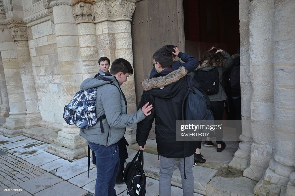 People arrive at the church of Surgeres to attend a mass on February 12, 2016 for the victims of the accident of a school bus which crashed into a truck near Rochefort on February 11, killing at least six children. At least six children were killed when a school minibus crashed into a truck in western France on February 11, police said, a day after another road accident involving a school bus left two youngsters dead. / AFP / XAVIER LEOTY