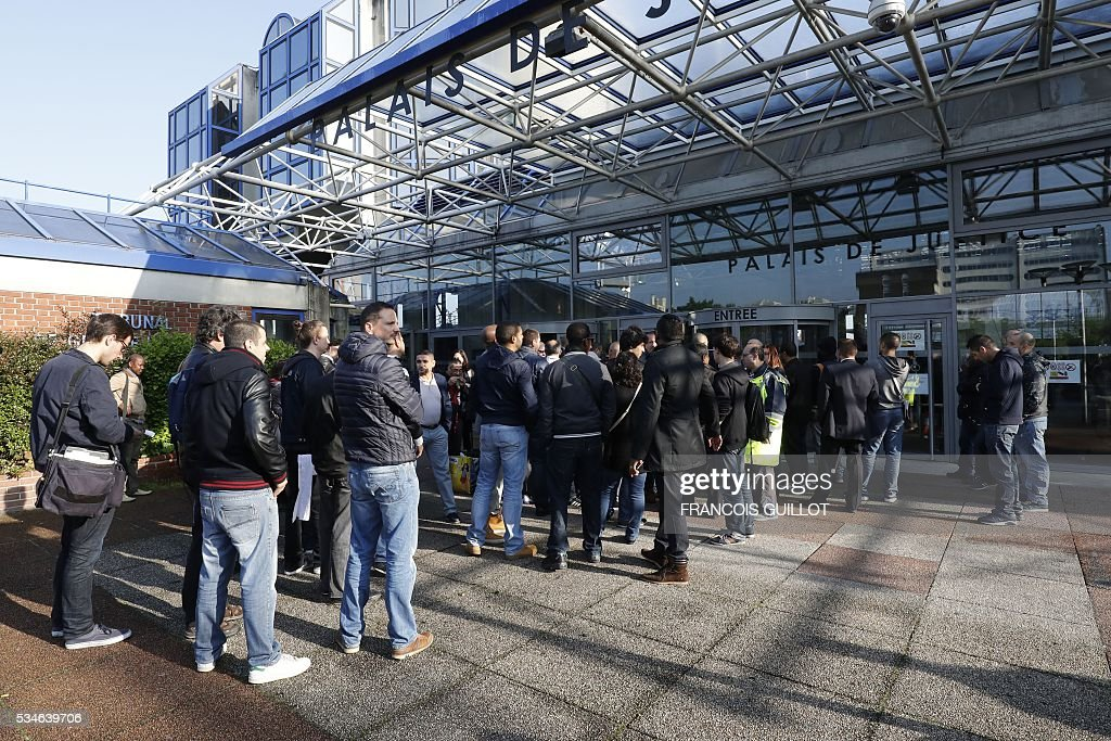 People arrive at the court of Bobigny, northern Paris on May 27, 2016 to attend the trial of five former Air France employees for attacking management -- ripping the shirts of two executives -- during protests over pay and conditions in October 2015.