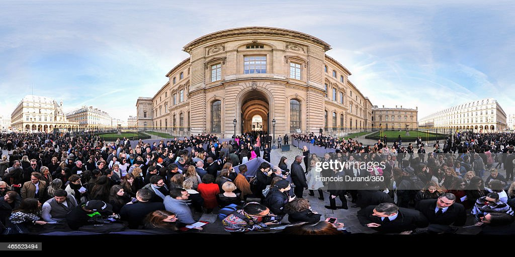 People arrive at the DIOR show at the Espace Ephemere Tuileries during Paris Fashion Week Fall Winter 2015/2016 on March 6 2015 in Paris France