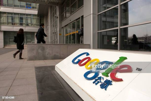 People arrive at the Google Inc office in Beijing China on Tuesday March 23 2010 Google Inc following through on a pledge to stop censoring search...