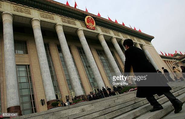 People arrive at the Great Hall of the People for the second plenary session of the National People's Congress China's parliament on March 9 2006 in...