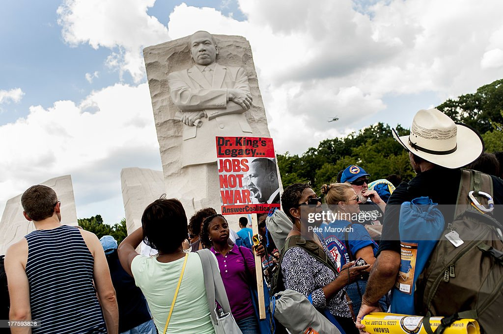 People arrive at the National Mall to celebrate the 50th anniversary of the March on Washington and Dr. Martin Luther King, Jr.'s 'I have a Dream' speech on the National Mall on August 24, 2013 in Washington, DC. A commemorative march and a rally along the historic route followed in 1963 is led by civil rights leaders Al Sharpton and Martin Luther King III.