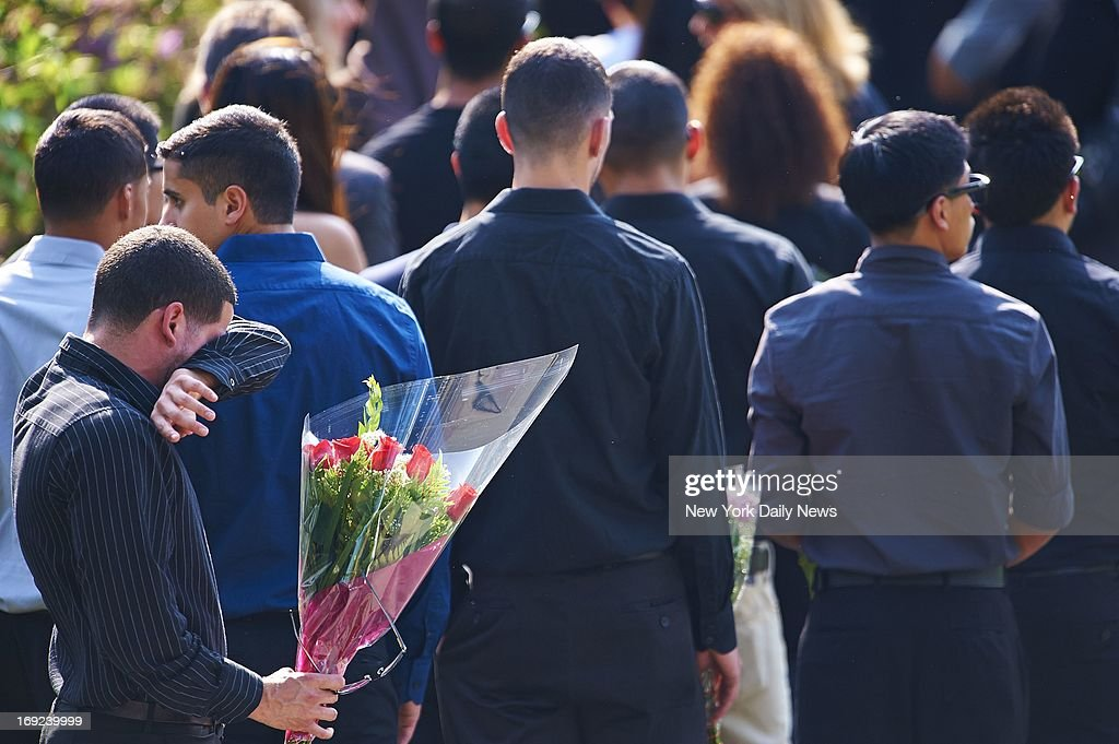 People arrive for a wake for Andrea Rebello, 21, at the Coffey Funeral Home in Tarrytown, N.Y. Rebello, was shot to death by a Nassau County police officer who responded to a robbery of Rebello's off-campus home in Uniondale, L.I. An armed intruder with a long rap sheet, Dalton Smith, was holding Rebello hostage and using her as a human shield when the officer, a veteran cop who had previously served with the NYPD fired eight shots.