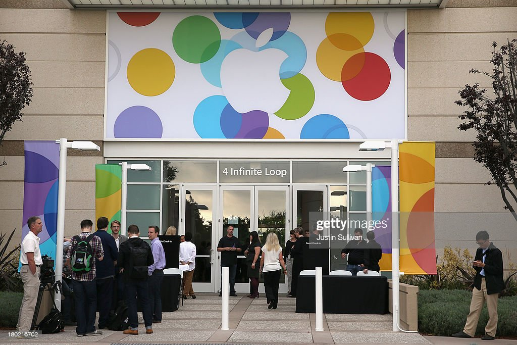 People arrive for an Apple product announcement at the Apple campus on September 10, 2013 in Cupertino, California. The company is expected to launch at least one new iPhone model.
