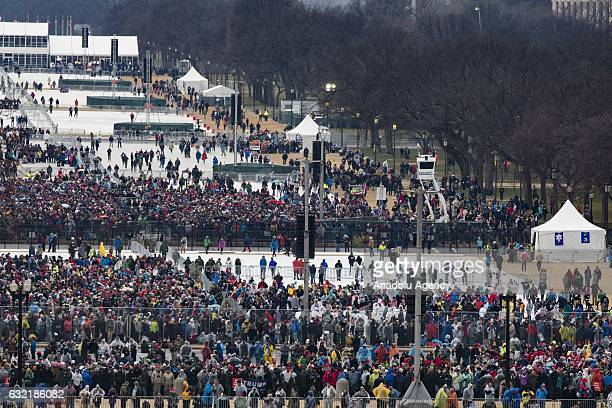 People arrive for Inauguration Ceremony of Donald Trump on the National Mall where Presidentelect Donald Trump will be sworn in as the 45th President...