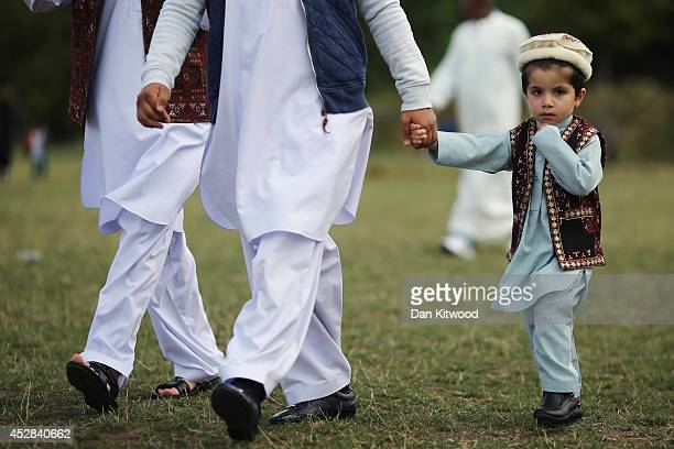 People arrive for morning prayer ahead of an Eid celebration in Burgess Park on July 28 2014 in London England The Muslim holiday Eid marks the end...