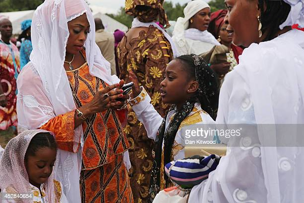 People arrive for morning prayers ahead of an Eid celebration in Burgess Park on July 28 2014 in London England The Muslim holiday Eid marks the end...