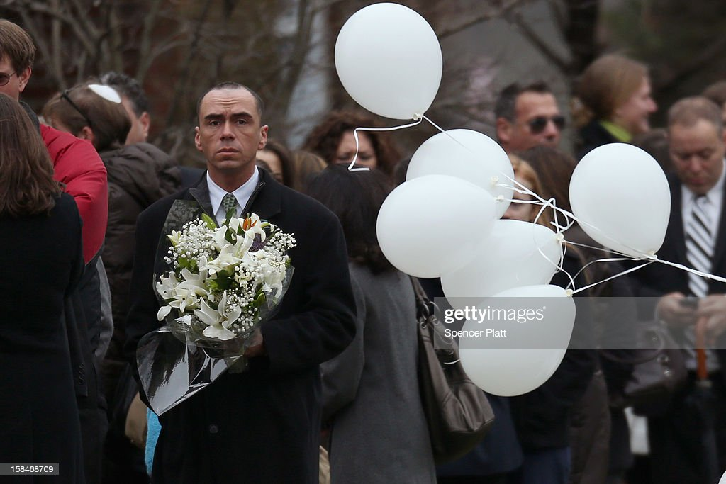 People arrive for the funeral services of six year-old Noah Pozner, who was killed in the shooting massacre in Newtown, CT, at Abraham L. Green and Son Funeral Home on December 17, 2012 in Fairfield, Connecticut. Today is the first day of funerals for some of the twenty children and seven adults who were killed by 20-year-old Adam Lanza on December 14, 2012.