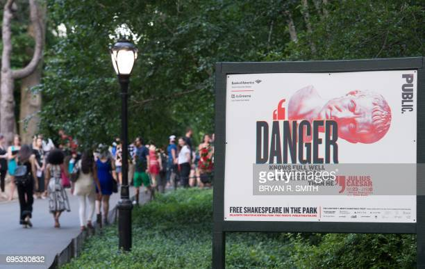 People arrive for the opening night of Shakespeare in the Park's production of Julius Caesar at Central Park's Delacorte Theater on June 12 2017 in...