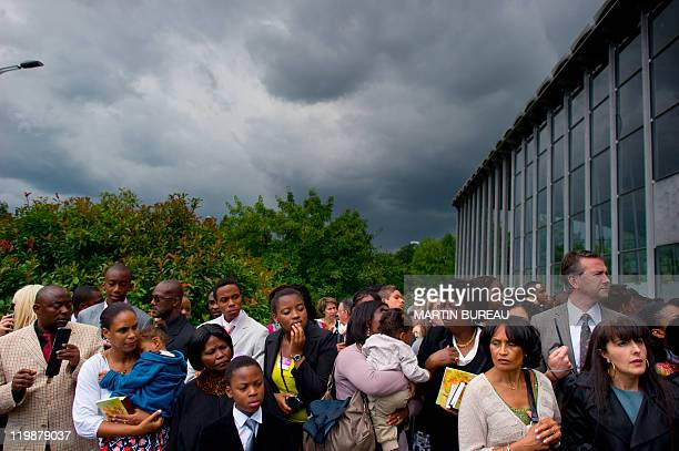 People arrive to attend a Jehovah's Witnesses assembly gathering 30000 believers on July 23 2011 in Villepinte Paris suburb European rights judges...
