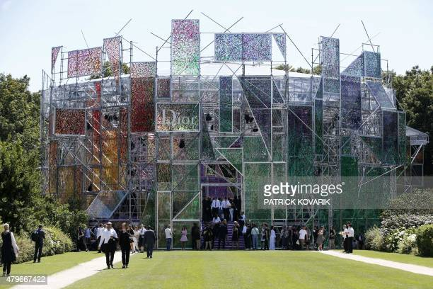 People arrive to attend Christian Dior 20152016 fall/winter Haute Couture collection fashion show on July 6 2015 in Paris AFP PHOTO / PATRICK KOVARIK...