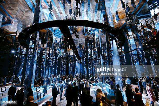 People arrive to attend Christian Dior fashion show during the 2016 spring/summer Haute Couture collection fashion presentation on January 25 2016 in...