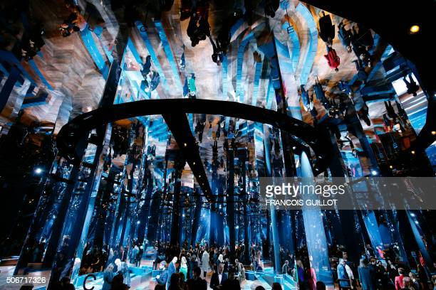 TOPSHOT People arrive to attend Christian Dior fashion show during the 2016 spring/summer Haute Couture collection fashion presentation on January 25...