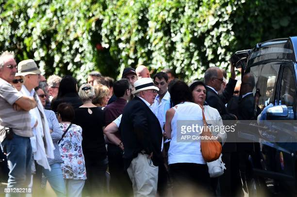 People arrive to attend the funeral ceremony of late French writer and journalist Gonzague Saint Bris at the Collegiate Church of SaintDenis in...
